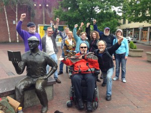 Group photo of protesters thanking Kesey statue.