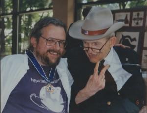 David W. Oaks poses with Justin Dart and his award.